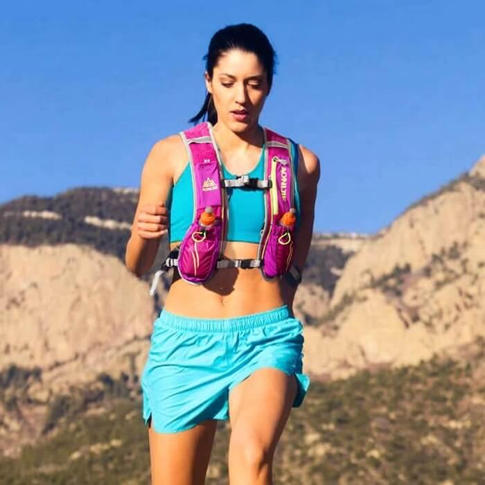 Girl wearing hydration vest for running