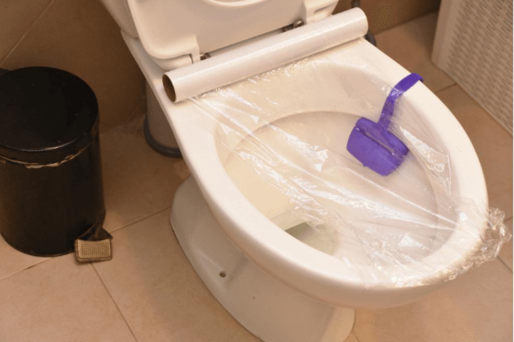 plastic wrap around toilet